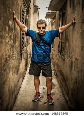 Adventurous traveler in the city - stock photo