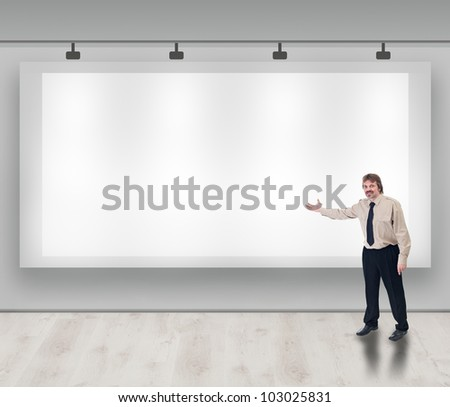 Advertise here concept with copyspace - friendly businessman inviting you - stock photo