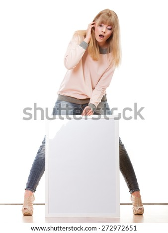 Advertisement concept. woman emotional face expression full body with blank presentation board. Female model showing banner sign copy space. Isolated
