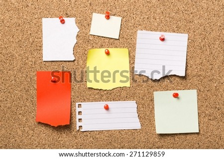 Advertisement. Different papers tacked on cork board. - stock photo