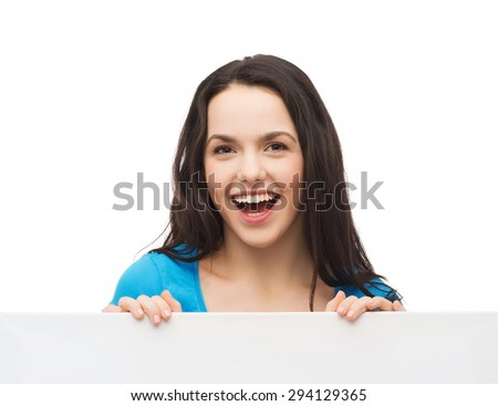advertisement, sale and people concept - smiling young girl with blank white board - stock photo