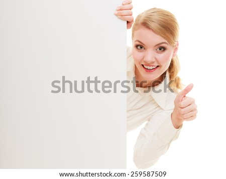 Advertisement. Woman hiding behind blank copy space banner showing thumb up isolated. Businesswoman recommending product - stock photo