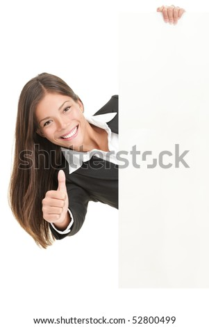 Advertisement woman holding sign. Businesswoman in suit giving thumbs up success sign and showing blank white billboard sign. Mixed race Chinese Asian / Caucasian woman isolated on white background. - stock photo
