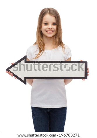 advertising and child concept - smiling little girl with blank arrow pointing left - stock photo