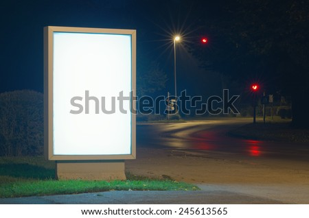Advertising billboard at night - stock photo