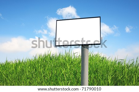 Advertising billboard on a green grass