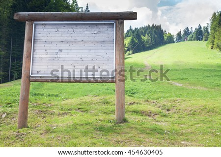 Advertising billboard outside the mountain in the summertime - stock photo