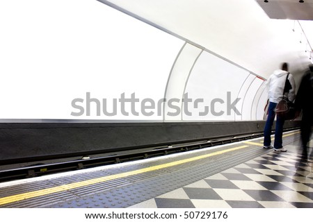 advertising blank poster site or billboard on london underground - stock photo