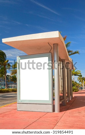 Advertising blank white side panel on a bus stop in Miami Beach Florida  - stock photo