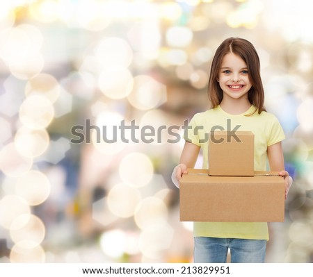 advertising, childhood, delivery, mail and people - smiling little girl holding cardboard boxes over holidays background - stock photo