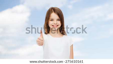advertising, childhood, summer, gesture and people concept - smiling little girl in white blank t-shirt showing thumbs up over natural background - stock photo