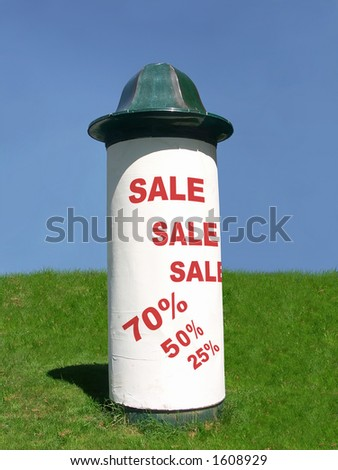 Advertising column with big sale notice - stock photo