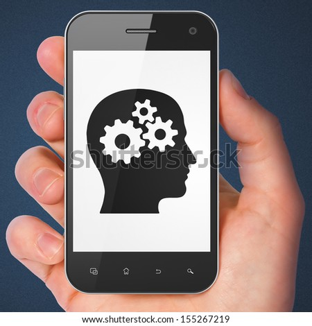 Advertising concept: hand holding smartphone with Head With Gears on display. Mobile smart phone in hand on Blue background, 3d render - stock photo