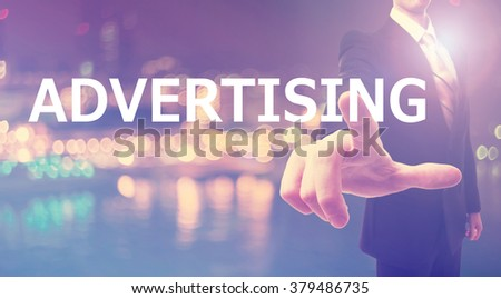 Advertising concept with businessman on blurred city background