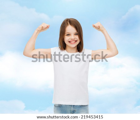 advertising, dream, childhood, gesture and people - smiling little girl in white blank t-shirt with raised arms over cloudy sky background - stock photo