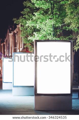 Advertising panels at night - stock photo