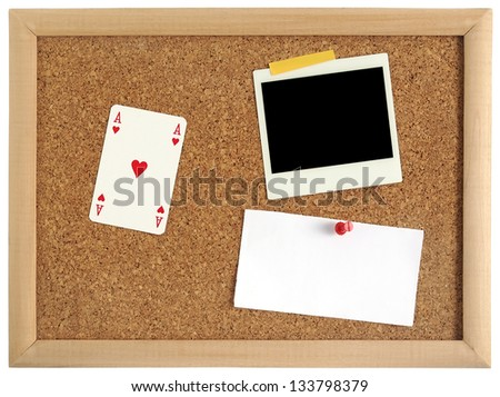 Advertising table with playing cars, instant photo and blank paper for notion - stock photo