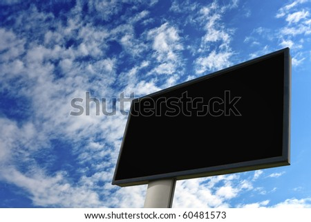 Advertising wall on blue sky - stock photo