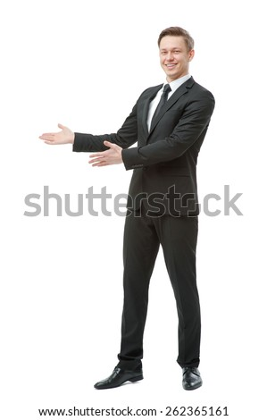 Advertising your product. Full length of happy young man in formalwear pointing copy space and smiling while standing isolated on white - stock photo