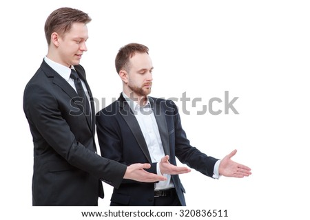Advertising your product. Two happy young businessmen pointing copy space while standing isolated on white