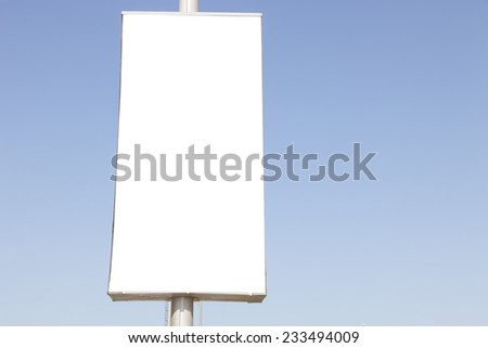 Advetisement or Ad billboard with blue sky  - stock photo