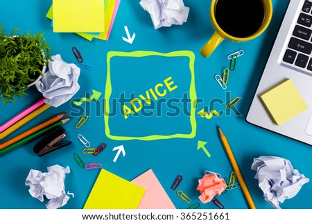 Advice motivation. Office table desk with supplies, white blank note pad, cup, pen, pc, crumpled paper, flower on wooden background. Top view - stock photo