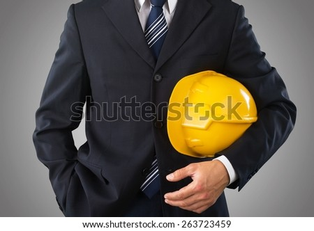 Advise. Businessman and an yellow cap - stock photo