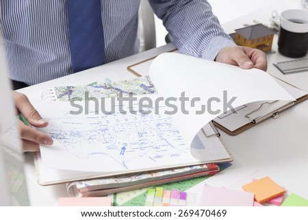 Advisor to look at the map - stock photo