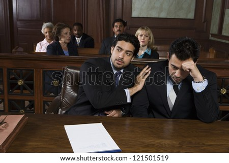 Advocate consoling upset client - stock photo