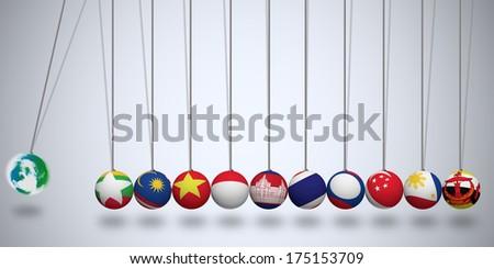 AEC World Newton's Cradle, Asean Economic Community - stock photo