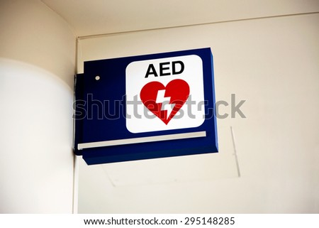 AED Automated External Defibrillator sign mounted to a wall. - stock photo