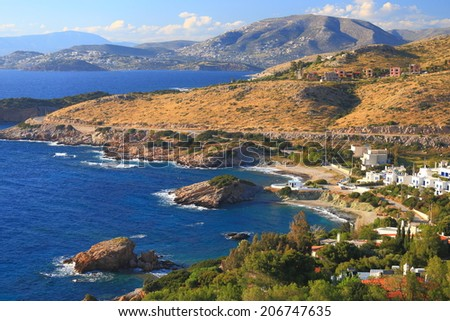 Aegean sea shore and small fisherman town and harbor, Cape Sounio, Greece - stock photo