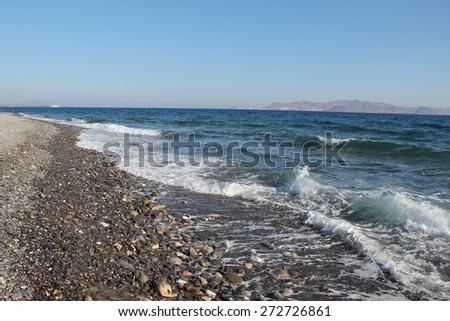 Aegean Sea / The Aegean Sea. Coast of the Aegean Sea on a Greek island of Kos. - stock photo