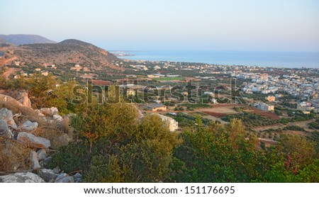 Aegean Sunrise - Sunrise lighting the Cretan mountains in Malia, Crete - stock photo