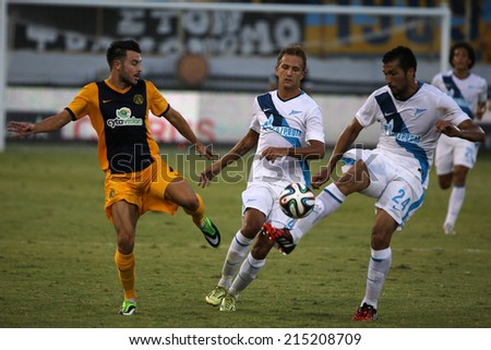 Ael Limassol player Nikolaou against Zenit player Garay during their Champions CYPRUS, LARNAKA-JUL 30:League third qualifying round second leg in Larnaca, Cyprus, Tuesday, July 30, 2014