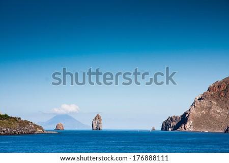 Aeolian Islands, Lipari,  two cliffs near Vulcano Island, Tyrrhenian Sea, Sicily, Italy  - stock photo