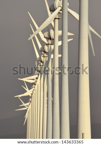 Aeolian park in perfect alignment on greyish background - stock photo