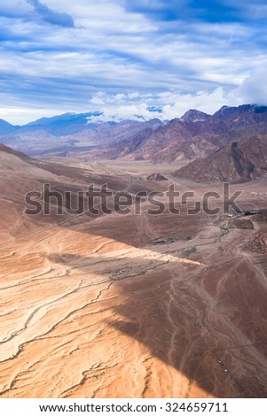 Aerail snowy and rock mountains - stock photo
