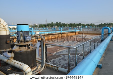 Aerated activated sludge tank at a wastewater treatment plant. - stock photo