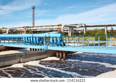 Aeration of wastewater in sewage treatment plant - stock photo
