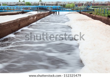 Aeration volumes for water in wastewater treatment factory. Long exposure - stock photo