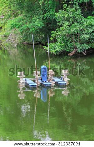 aerator, water pollution treatment machine, Chai Pattana, Thailand - stock photo