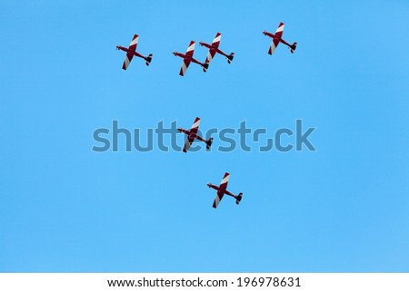 Aerial Acrobatics planes flying in tight formation at Airshow
