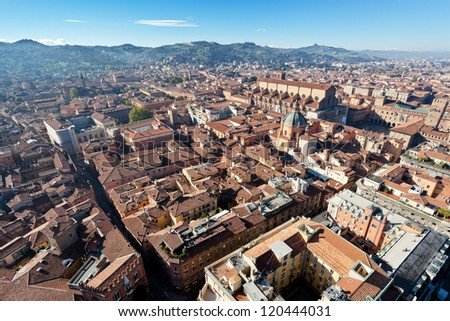 aerial bird eye view from Asinelli Tower on Bologna with hills, Italy - stock photo