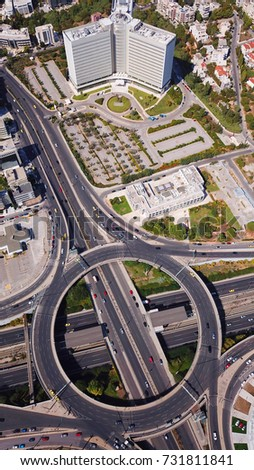 Aerial bird's eye photo of highway and ring road passing through city center