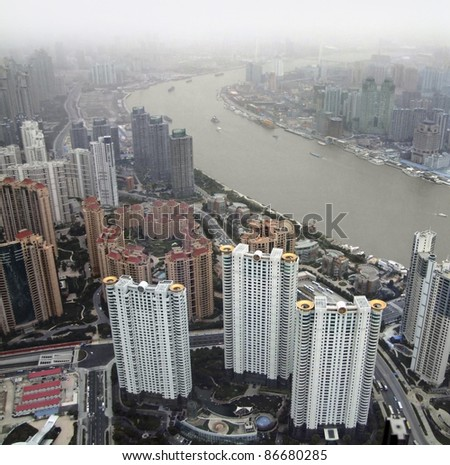 aerial city view showing Pudong, a district of Shanghai in China