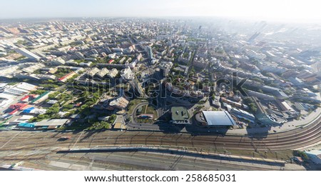 Aerial city view with crossroads on roads, houses and buildings, parks and parking lots, bridges - stock photo