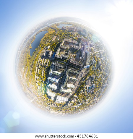 Aerial city view with crossroads, roads, houses, buildings, parks and parking lots, bridges. Copter shot. Little planet mode. - stock photo
