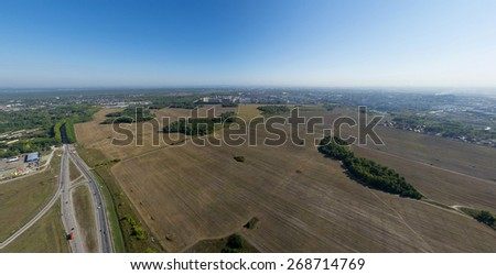 Aerial city view with crossroads, roads, houses, buildings, parks, parking lots, bridges. Coptere shot. Panoramic image. - stock photo