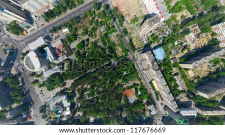 Aerial city view with crossroads, roads, houses, parks, parking lots, bridges - stock photo